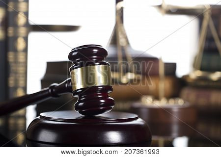 Law theme. Mallet of the judge. Books.