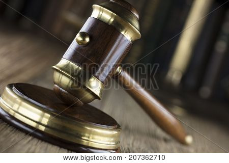 Gavel on  wooden table in the court library. Law concept.