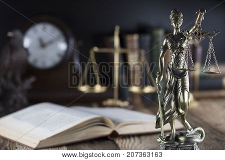 Legal system. Law and justice concept.Statue of justice and books.