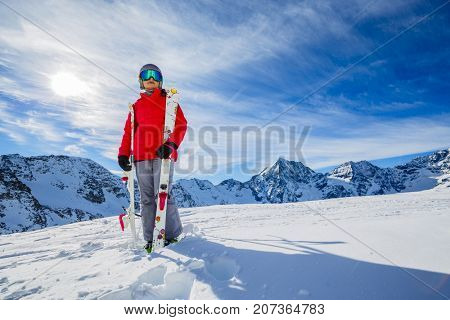 Girl on skiing on snow on a sunny day in the mountains. Ski in winter seasonon, the tops of snowy mountains in sunny day. South Tirol, Solda in Italy.