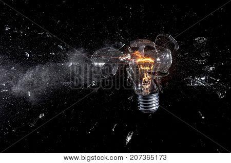 glass bulb explosion on black background