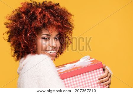 Afro Girl Posing With Gift Box, Smiling.