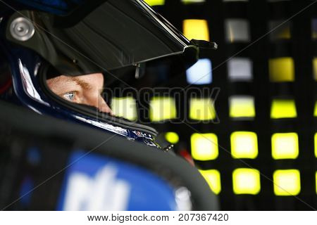 September 30, 2017 - Dover, Delaware, USA: Dale Earnhardt Jr. (88) straps into his car to practice for the Apache Warrior 400 at Dover International Speedway in Dover, Delaware.