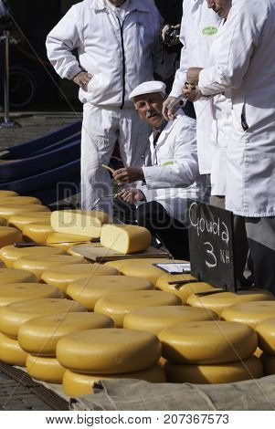 ALKMAAR NETHERLANDS - CIRCA APRIL 2007 - Every Friday from April through September the Alkmaar Cheese Market takes place on the square Waagplein in town. Traders evaluate the cheese