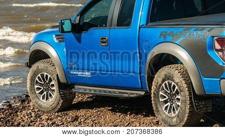 Khabarovsk, Russia - october 20, 2016: Ford F150 Raptor SUV is on the road driving on dirt . pickup