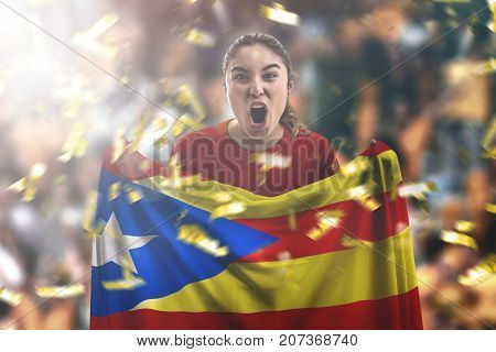 Catalan female fan holding the national flag