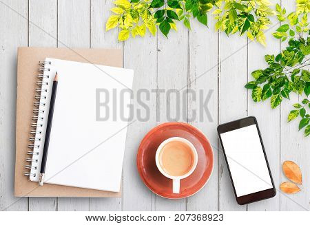 Top view open notebooksmart phonepencil and cup of coffee on rustic white wooden table background. Cozy autumn breakfast. Fall bucket list. Flat lay style.