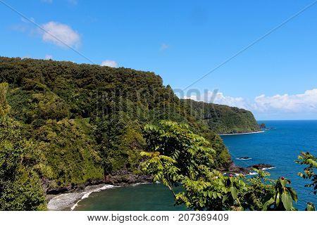 Road to Hana  winding along cliff edge on the Island of Maui, Hawaii.