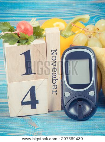 Date 14 November As Symbol Of World Diabetes Day, Glucose Meter For Measuring Sugar Level And Fruits