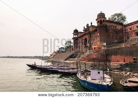 VARANASI INDIA - MARCH 14 2016: Horizontal picture of the amazing architecture of Chet Singh Ghat in front of Ganges River in the city of Varanasi in India