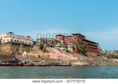 VARANASI INDIA - MARCH 14 2016: Wide angle picture of the beautiful architecture of Shivala Ghat in front of Ganges River in the city of Varanasi in India