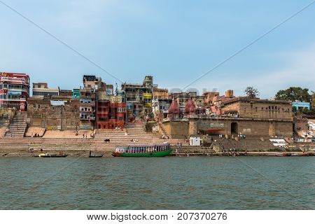 VARANASI INDIA - MARCH 14 2016: Front picture of the Raja and Narad Ghat in front of Ganges River in the city of Varanasi in India
