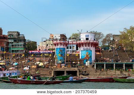 VARANASI INDIA - MARCH 14 2016: Horizontal picture of the stairs of Dashashwamedh Ghat in Ganges River during day time in Varanasi India.