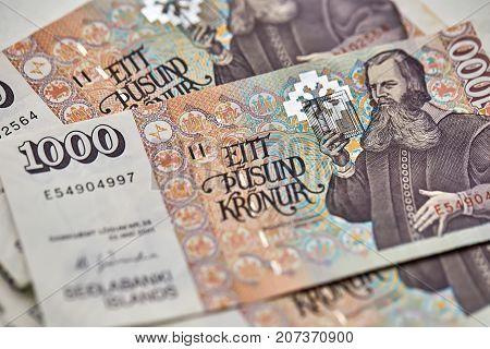 Few colorful 1000 banknotes of Icelandic krona. Horizontal macro photo.