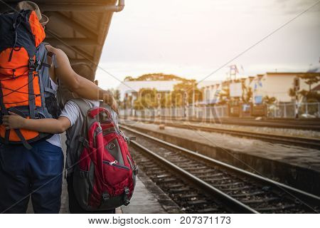 Father and sons  backpack waiting train at train station in Thailand.Rare of travelers.