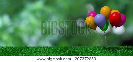 Birthday party concept. Group of colorful balloons on green grass and green abstract background, copy space. 3d illustration