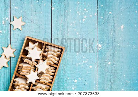 Traditional German Star Cookies in a gift box over a light blue background. Christmas or Yom Kippur.