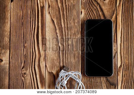 black telephone isolated on a wooden background