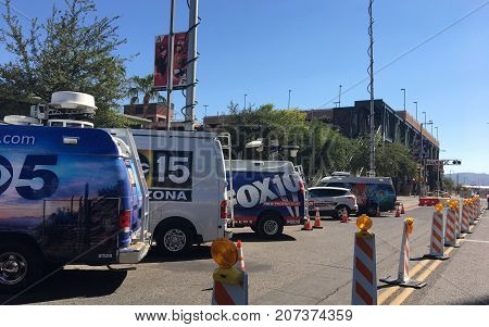 PHOENIX AZ USA - OCTOBER 4 2017: Major news TV agencies parked next to DBack Arena in anticipation of Do Or Die game Phoenix downtown
