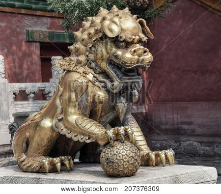 Guardian lion in the Forbidden city in Beijing in China.