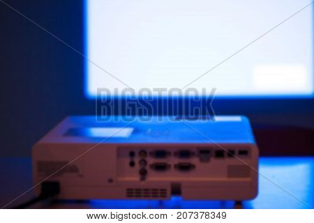 Blurred - projector for presentation in a meeting room