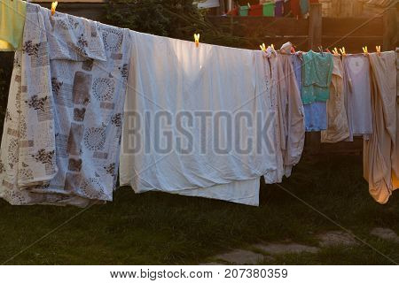 linen and clothes hanging outside at sunset