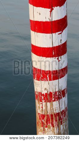 Red And White Pole On The Sea
