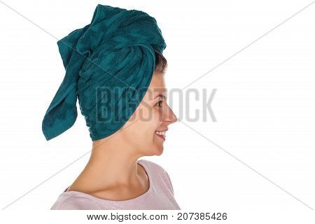 Beautiful young female with bath towel on head - profile view on isolated background