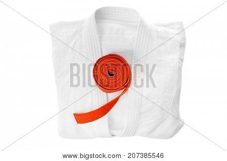 Karate uniform with orange belt on white background