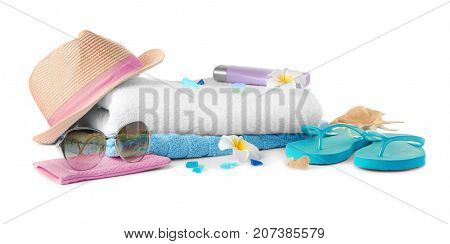 Composition with summer accessories on white background