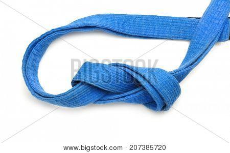 Blue karate belt on white background
