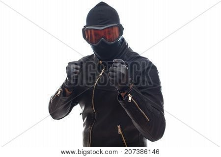 Dangerous burglar dressed in black wearing a mask on head - isolated background