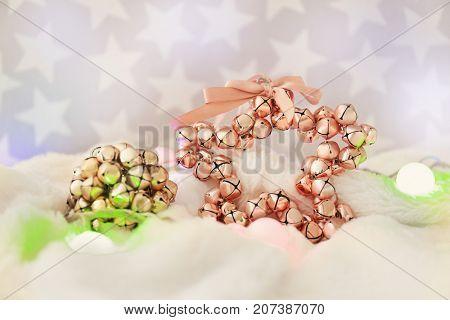 Christmas jingle bells and garland on blanket