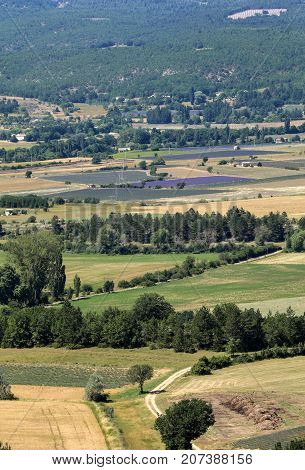 Patchwork of Farmer's fields in valley below Sault Provence France