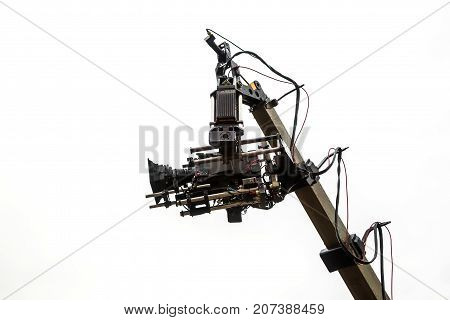 Professional video camera on the crane on a white background. technology. space for text
