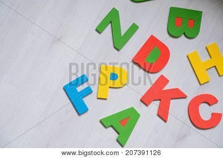 Colorful Letters On Background Closeup A Close Up Shot Of Abc. Educational Abc Toys For Kids. Presch
