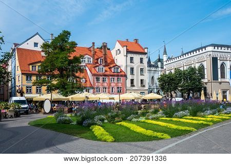 Livu square beautiful colorful houses with flowerbed on foreground in the Old town of Riga, Latvia