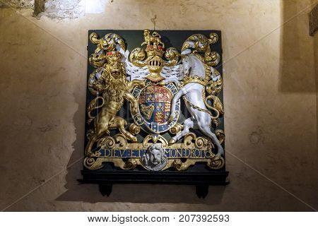 LONDON, GREAT BRITAIN - MAY 16, 2014: This is the old medieval coat of arms of Britain from the Tower of London.