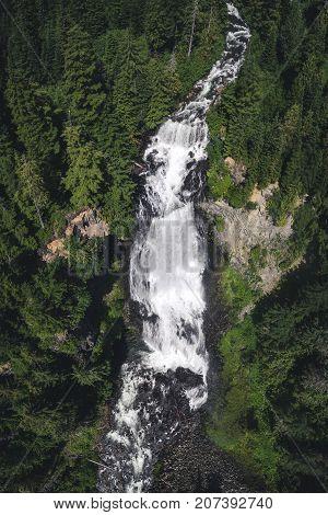 Birds eye view of beautiful waterfalls in British Columbia forest