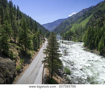 Opt outside contrast of Highway 2 running alongside Wenatchee River in Tumwater Canyon by Leavenworth Washington