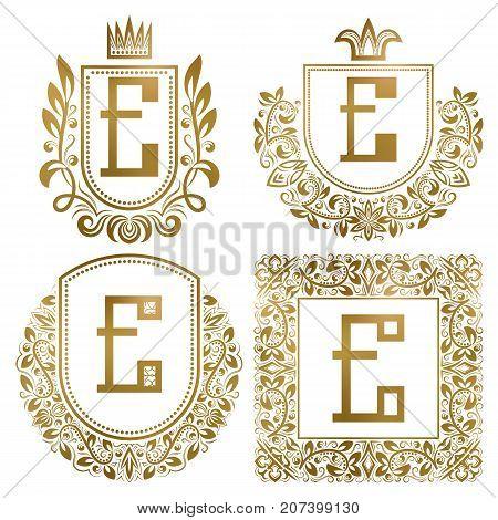 Golden vintage monograms set. Heraldic logos with letter E.