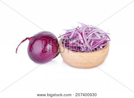 sliced shallot or red onion in wooden bowl and on white background