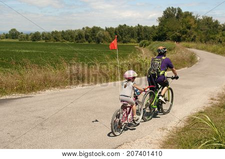 Family cyclo holidays. The bike itinerary of Grado Friuli Venezia Giulia, region of Italy. Family, education, recreation and sport concept.
