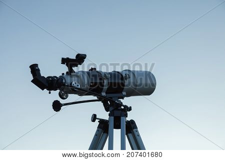 Telescope for amateur astronomy on a tripod.