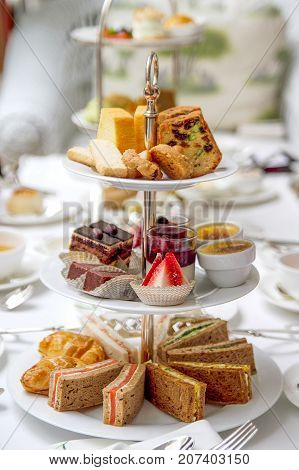 High tea set with dessert, sandwich, tart