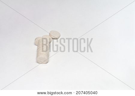 A Stack Of Beige Pills With Inclusions And A Dividing Line