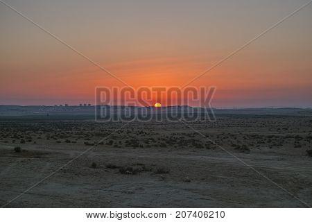 Sunrise in the Negev desert. On the horizon, the city of Dimona (Israel)