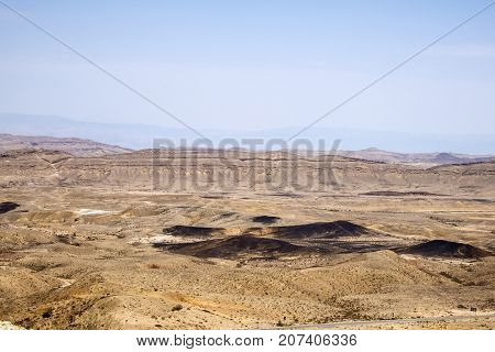 The large crater Ha-Makhtesh Ha-Gadol near Yeruham and the road leading to the colored sands (Israel)