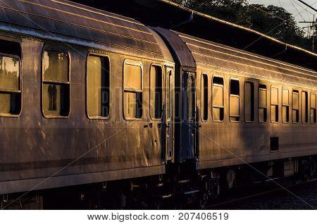 RAILWAY WAGONS - Passenger train wagon on the platform of the train station