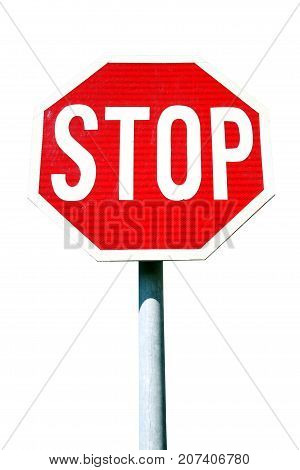Red stop sign cut out and isolated on a white background